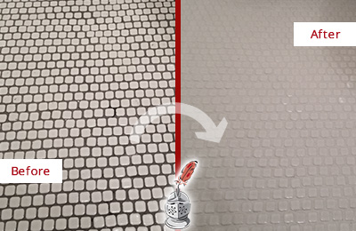 Before and After Picture of a Bellevue Hard Surface Restoration Service on a Bathroom Tile Floor Recolored to Fix Grout Color